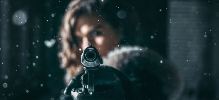 female shooter with pistol
